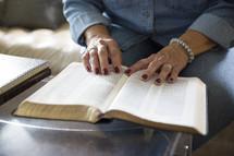 an elderly woman reading a Bible