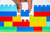Building a wall with plastic blocks