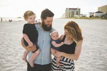 a family portrait on a beach