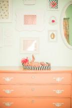 newborn baby girl on a dresser