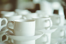 coffee cups and saucers in a diner