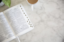 open Bible on a marble countertop