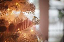 close up of a gold ornament on a beautifully decorated tree