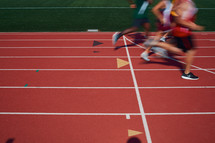 runners racing on a track