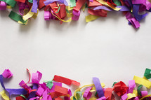 White paper bordered with colorful confetti.