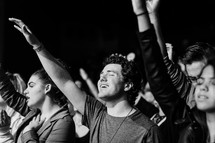 audience with hands raised in praise at a concert