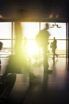 shadows walking through an airport terminal