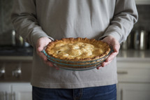 a man holding a pie