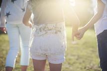 siblings walking holding hands