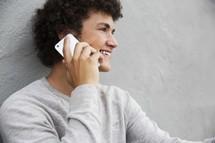 teen boy talking on a cellphone