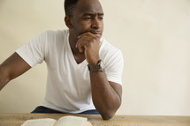 an African American man reading a Bible