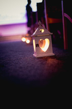 heart shaped cut-out in a lantern