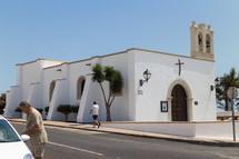 A white adobe church.