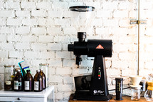 syrup and espresso machine in a coffee shop