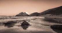 tide washing onto rocks on a beach