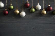 Christmas ornaments hanging from twine