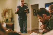 men gathered at a bible study