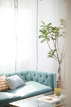 throw pillows on a turquoise couch