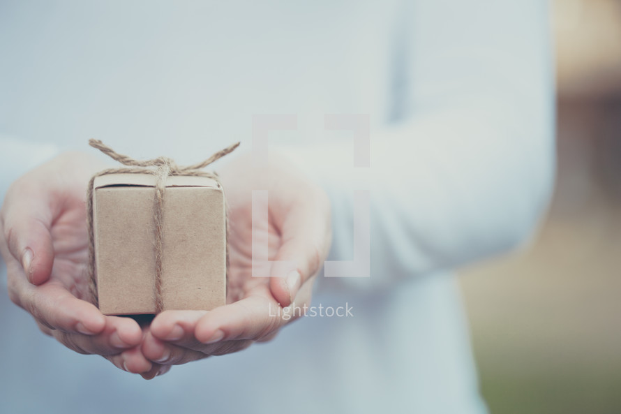 a small gift in a man's hands