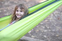 smiling girl in a hammock