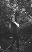 a woman balancing on rocks outdoors