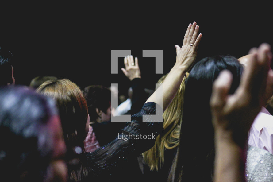 congregation with raised hands in worship
