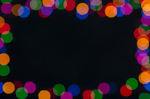 colored bokeh holiday lights background.