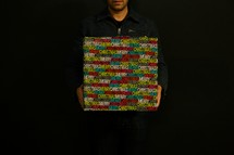 man holding a wrapped Christmas gift.