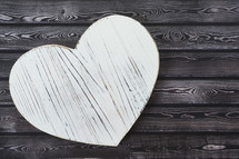wood heart shape on wood background
