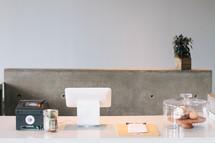 countertop, tip jar, and register