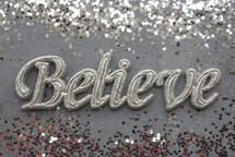 silver glitter and word Believe