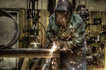 Welder in a machine shop.