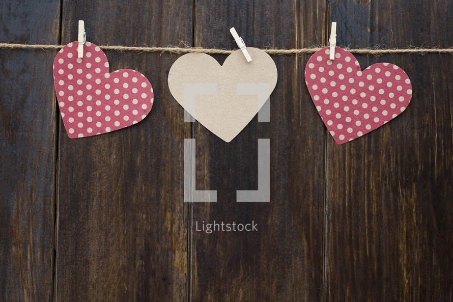 paper hearts hanging on twine for Valentines day