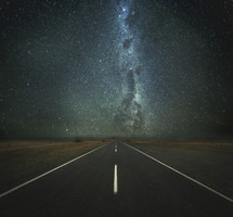 a road under the stars