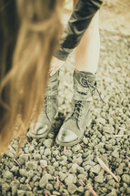 girl fastening the a buckle on her boots