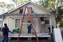 working on a habitat for humanity house