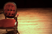 empty red chair in an empty room