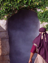 One of Jesus Disciples peers into the open and empty tomb of Jesus after He rose from the dead after three days, Just as He Said He would do before being crucified on the cross. The miracle of Easter and Christianity is not that Jesus died but that He arose from the dead and conquered both hell and the grave.
