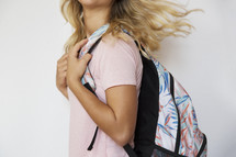 a student with a book bag