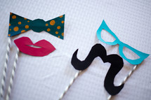 Lips, mustache, bow tie and glasses party favors.