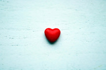 red heart on a white wood background