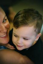 A woman holding a little boy.