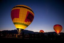 hot air balloon festival in a desert