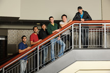 group of diverse male students standing on stairs