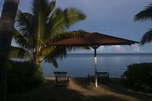 umbrella in the sand near the ocean - tropical setting