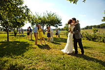 bride and groom and couples kissing