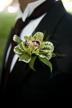 corsage on a man's lapel