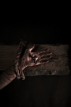 Jesus' hand nailed to the cross
