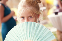girl behind Chinese fan