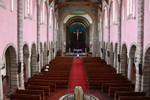 people praying inside a church